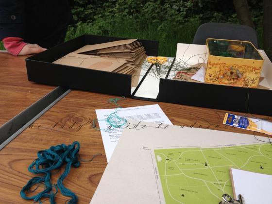book binding, needle and thread