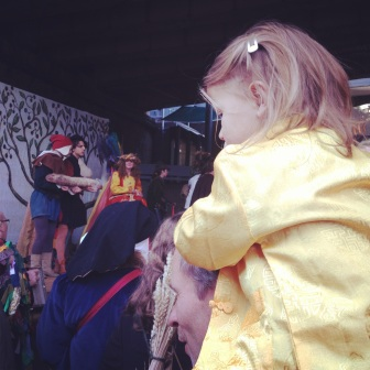 little girl on her dads shoulders, apple day in borough market, girl watching the lions part, autumnal festivity, cute little girl in borough market, apple day october 20