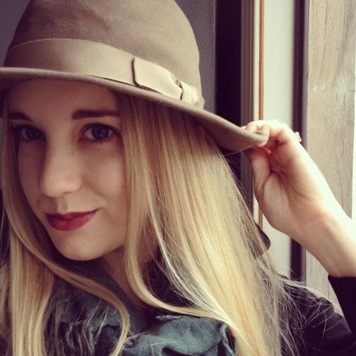 girl in hat, blondie, red lipstick, winter accessories, smirking, blue eyed girl, blonde hair, grey hat, sporting a hat, teal scarf, smile
