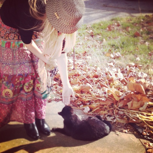 witchy, girl with a black cat, hippie skirt, black leather shoes, girl wearing a hat, blonde girl, autumn leaves, girl wearing a skirt, animal lover, binks the black cat, nero corleone, the lades guide to adventure, rosalie melin