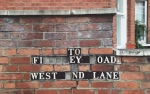 finchley road, london, london streets, old street signs, united kingdom, photography, brick background, west end lake, northwest london, exploring europe, missing letters, black and white letters